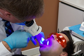 Patient receiving VELScope oral cancer screening